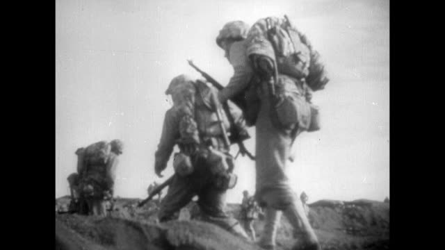 marines maneuvering on beach of iwo jima explosions soldiers spread across island soldiers artillery cannons in ditches firing upon mount suribachi... - battle of iwo jima stock videos & royalty-free footage