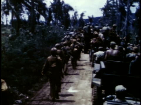 marines marching along road past parked jeeps / guam - guam stock videos & royalty-free footage