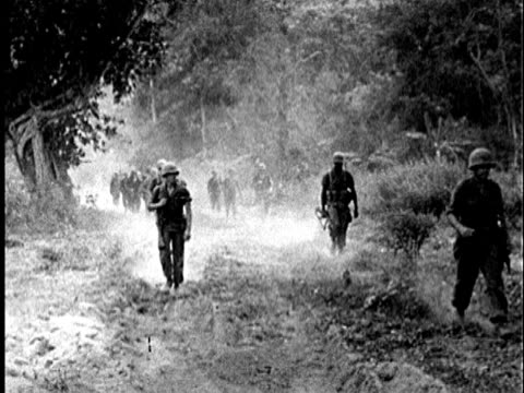 S Marines marching in 2 lines on jungle trail in Vietnam / AUDIO