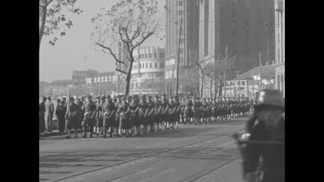 us marines marching in formation along street in shanghai / marines marching in formation turn and march through gate / marines marching in formation... - parade stock videos & royalty-free footage