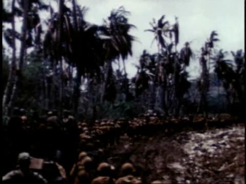 marines marching on narrow dirt road / guam - guam video stock e b–roll