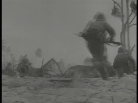 betio tarawa us marines moving on beach pan fighting explosion us marine firing rifle in smoke behind marine using machine gun us marines firing from... - battle stock videos & royalty-free footage