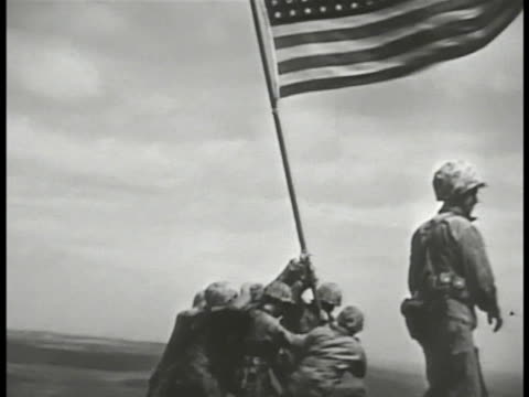 marines of easy company raising american flag ira hayes franklin sousley john bradley and harlon block michael strank rene gagnon wwii - iwo jima island stock videos & royalty-free footage