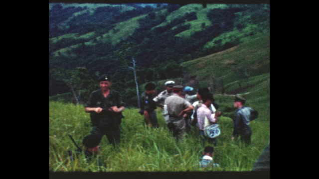 Marines on verdant hillside in British North Borneo From the home movie collection of Jack Dennis Boles Boles spent 17 years in the Colonial Service...