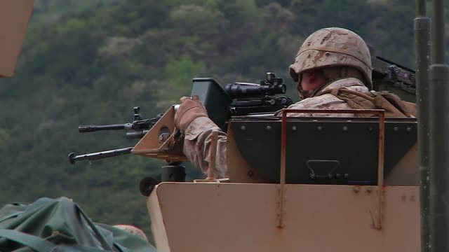 stockvideo's en b-roll-footage met marines perform mechanized assault - humvee