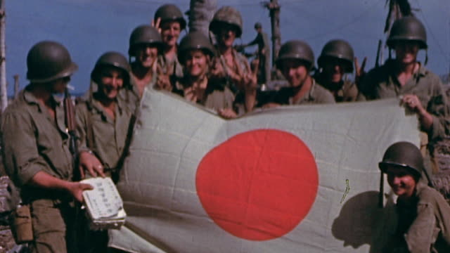 marines posing with captured japanese flag and marines posing for camera on pacific island during wwii - japan flag stock videos & royalty-free footage