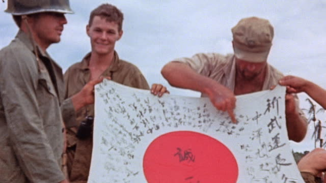 la marines posing with captured japanese flag / guam mariana islands - mariana islands stock videos and b-roll footage