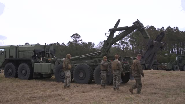 us marines prepare equipment for an improved ribbon bridge during a field exercise at camp lejeune north carolina on january 14 2019 - 迷彩柄点の映像素材/bロール