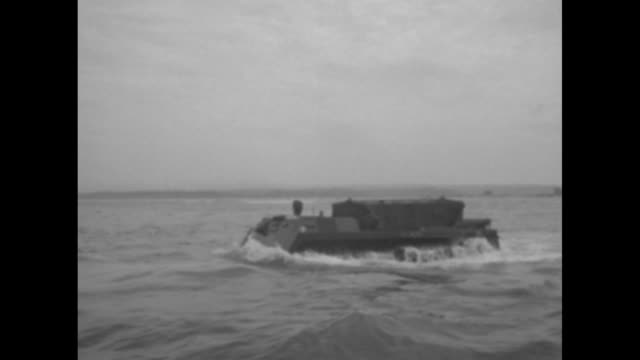 vidéos et rushes de marines presenting colors in ceremony at marine corps base camp pendleton in california / shot from amphibious vehicle of line of amphibious vehicles... - véhicule amphibie