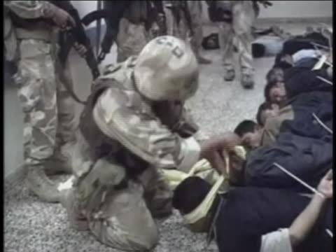 marines process prone prisoners in iraq. - al fallujah stock videos & royalty-free footage
