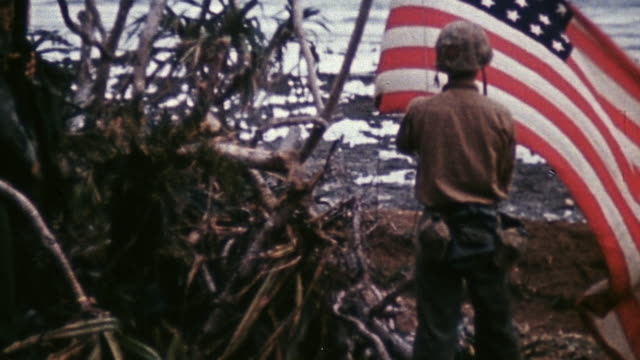 marines raising american flag on a tree and saluting flag as it blows in the wind / okinawa japan - editorial stock videos & royalty-free footage