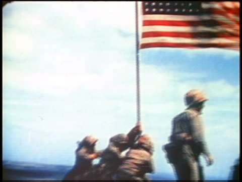 marines raising u.s. flag on iwo jima island / documentary - iwo jima island stock videos & royalty-free footage