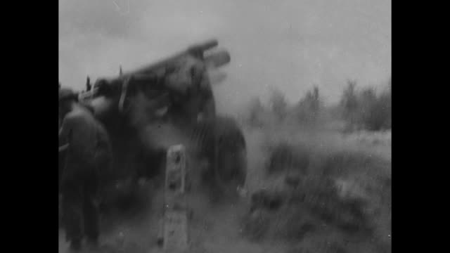 us marines regroup on beach / tank rolls along / vs marines fire artillery at distant targets smoke rises in hills / tank in brush / soldiers with... - saipan stock videos and b-roll footage