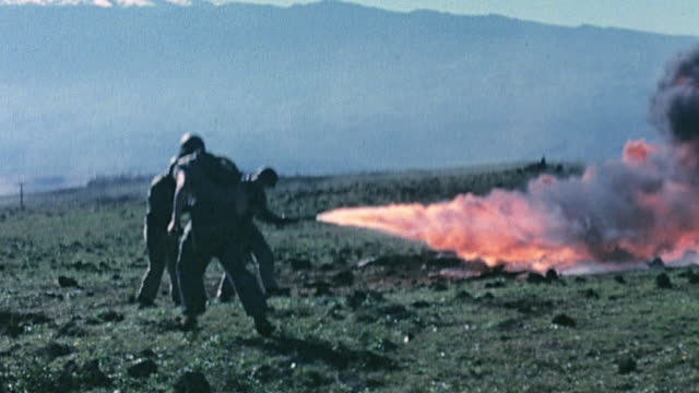 marines retreating behind flamethrower, marine throwing a grenade, smoke rising from buried enemy pillbox, and an explosion during world war ii... - world war ii video stock e b–roll