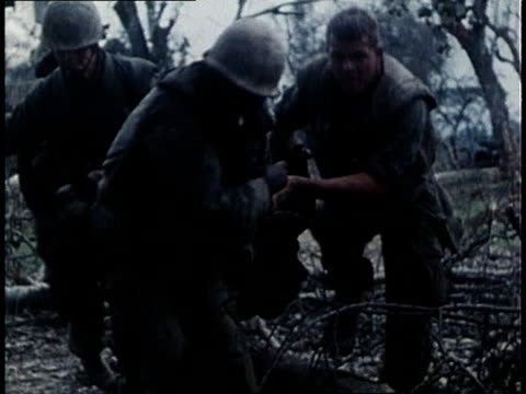 marines running for cover under machine gun fire / marines dragging wounded soldier to cover / jeep loaded with wounded driving away - south vietnam stock videos & royalty-free footage