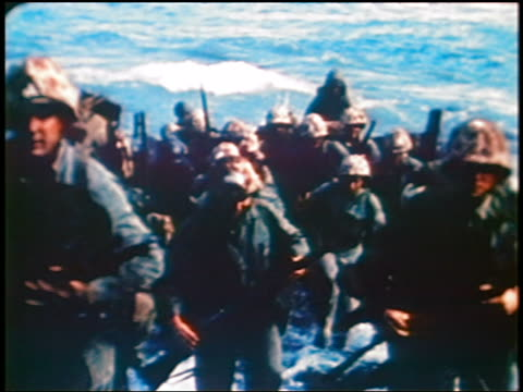 marines running from boat thru surf to beach of iwo jima island / documentary - iwo jima island stock videos & royalty-free footage