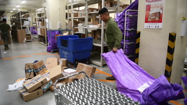 us marines sorting mail and parcels for distribution at marine corps air station iwakuni - packing stock videos & royalty-free footage