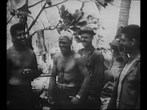 us marines stand around relax laugh after end of battle of saipan in world war ii / 2shot africanamerican and white marines smile / montage cu... - saipan stock videos and b-roll footage