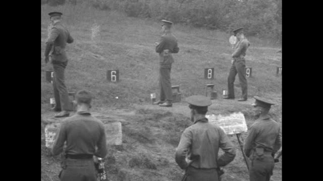 vídeos de stock, filmes e b-roll de us marines stand at attention listen to general john lejeune instructing them to shoot to kill when necessary / high shot large group of marines wave... - atlântico central eua
