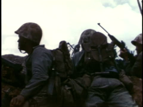 marines taking cover and moving on beach / guam - marines stock videos & royalty-free footage