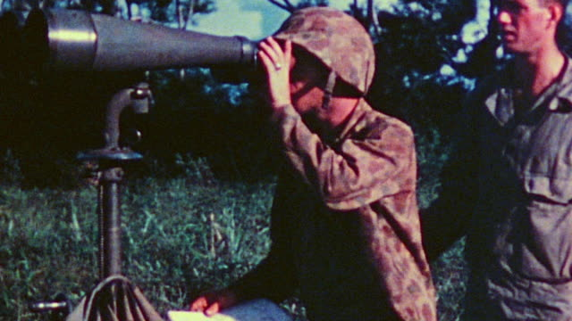 s marines taking turns looking through field binocular telescope and referring to coordinate maps during wwii / tinian mariana islands - mariana islands stock videos and b-roll footage