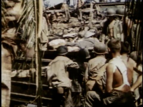 marines taking wounded on stretchers to amphibious vehicle for evacuation / guam - guam stock videos & royalty-free footage