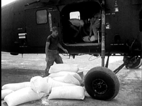 S Marines unloading sacks of food aid from helicopter / Vietnam / AUDIO