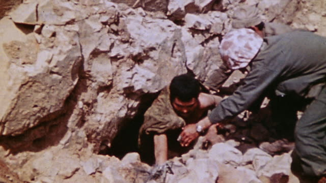 marines using native interpreter to convince japanese soldiers to come out of tunnel mouth and surrender / iwo jima, japan - iwo jima island stock videos & royalty-free footage