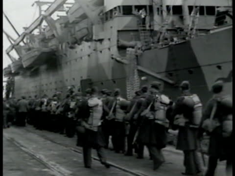 marines w/ gear up gangplank to transport ship. soldiers on line, waiting on dock by side of ship. vs men carrying large bags on shoulders onto boat,... - 1942 stock videos & royalty-free footage