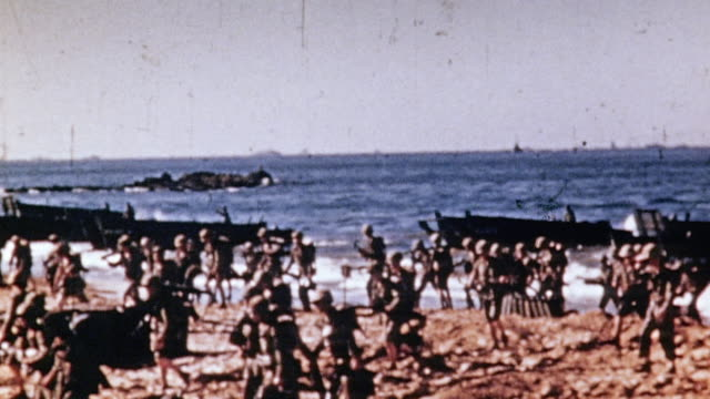 marines wading ashore from landing craft / iwo jima japan - iwo jima island stock videos & royalty-free footage