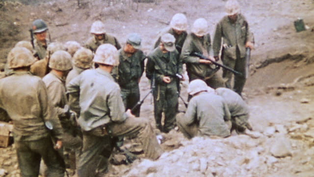marines waiting at tunnel mouth smoke drifting out and away / iwo jima japan - schlacht um iwojima stock-videos und b-roll-filmmaterial