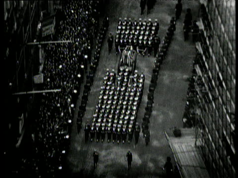 marines walking in formation around sir winston churchill's coffin zoom out to crowds on london streets watching state funeral procession london 30... - funeral procession stock videos & royalty-free footage