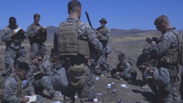 us marines with 1st light armored reconnaissance battalion 1st marine division units conduct land navigation exercise during a rifle squad... - base camp stock videos & royalty-free footage