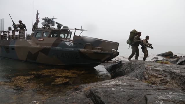 us marines with 1st platoon 1st reconnaissance battalion 1st marine division and norwegian coastal ranger commandos disembark from a cb90class fast... - platoon stock videos and b-roll footage