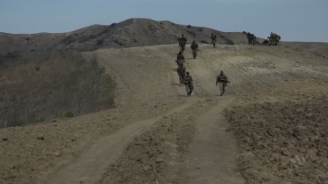 marines with 2nd battalion, 1st marine regiment, search for their next checkpoint during the land navigation portion of the 1st marine division super... - 連隊点の映像素材/bロール