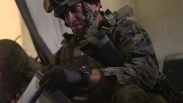 US Marines with 2nd Law Enforcement Battalion II Marine Expeditionary Force Information Group raid a village gather evidence and register civilians...
