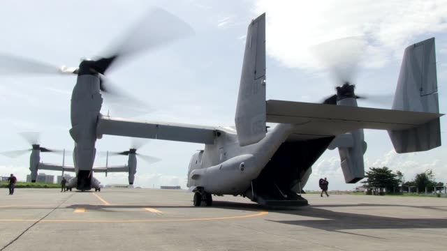 us marines with 3rd marine expeditionary brigade conduct humanitarian assistance operations using mv22 ospreys to bring a japanese self defense force... - osprey stock videos & royalty-free footage
