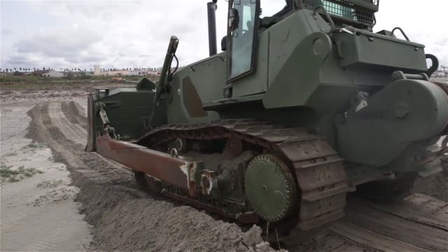 US Marines with 7th Engineer Support Battalion help the Marine Corps Base at Camp Pendleton Wildlife Management Section cultivate soil in order to...
