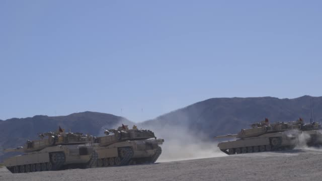 us marines with a company conduct a battlesight zero exercise on m1a1 abrams battle tanks at marine corps air ground combat center twentynine palms... - army stock videos & royalty-free footage