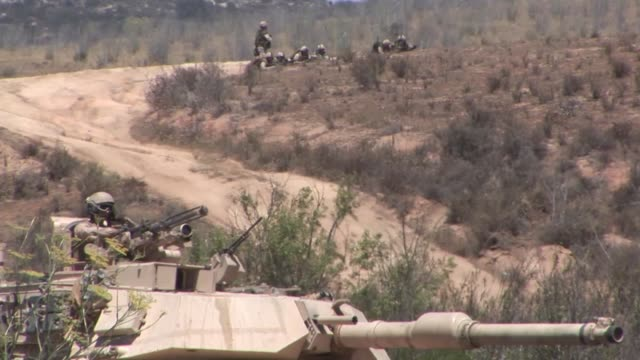 marines with alpha company, 1st tank battalion, and canadian soldiers with 2nd battalion, royal canadian infantry regiment conduct a mechanized... - royal marines stock videos & royalty-free footage