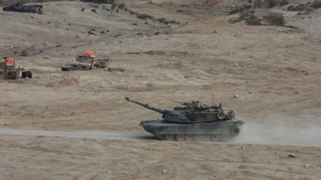 us marines with animal company marine airground task force6 conduct a mechanized assault course with a m1a1 abrams battle tank during integrated... - 装甲車点の映像素材/bロール
