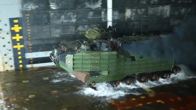 marines with bravo company, battalion landing team launch from amphibious transport dock uss green bay into philippine sea for simulated mechanized... - amphibious vehicle stock videos & royalty-free footage