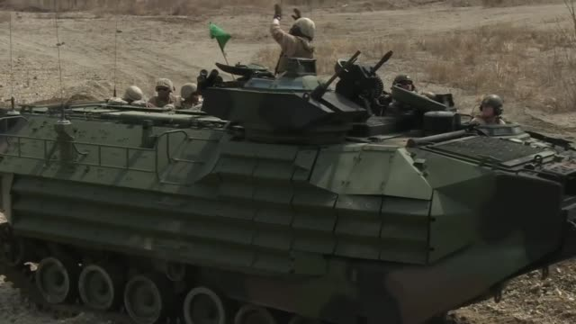 us marines with combined assault battalion iii marines expeditionary force conducted mark19 and m250 cal training on assault amphibious vehicles in... - amphibious vehicle stock videos and b-roll footage