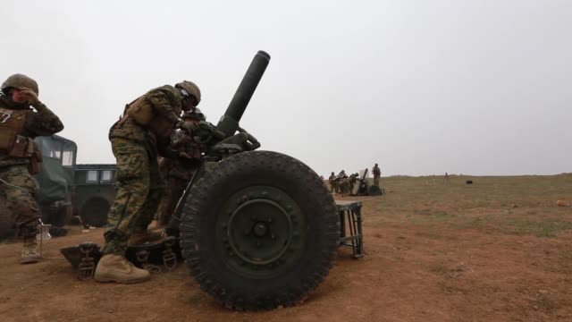 us marines with echo battery 2nd battalion 11th marine regiment fire 120mm mortar systems alongside soldiers from the japan ground selfdefense force... - japan ground self defense force stock videos and b-roll footage