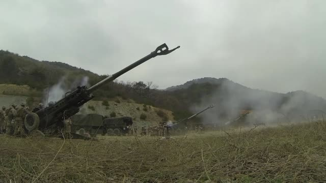 us marines with golf battery 2nd battalion 11th marines fire for effect on a gun line april 3 at su seongri range in pohang republic of korea during... - military exercise stock videos and b-roll footage