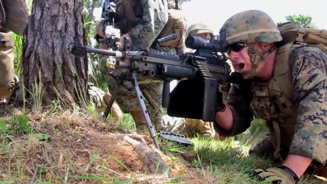 us marines with kilo company battalion landing team 3rd battalion 5th marines 31st marine expeditionary unit conduct a vertical assault on a military... - military attack stock videos and b-roll footage
