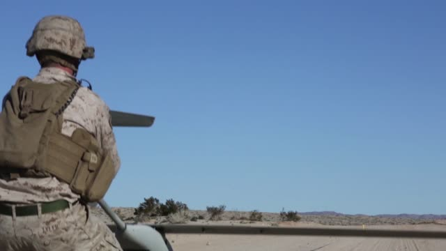 us marines with marine airground task force6 test an unmanned aeriel system lockheed martin stalker over range 220 during integrated training... - 無人航空機点の映像素材/bロール