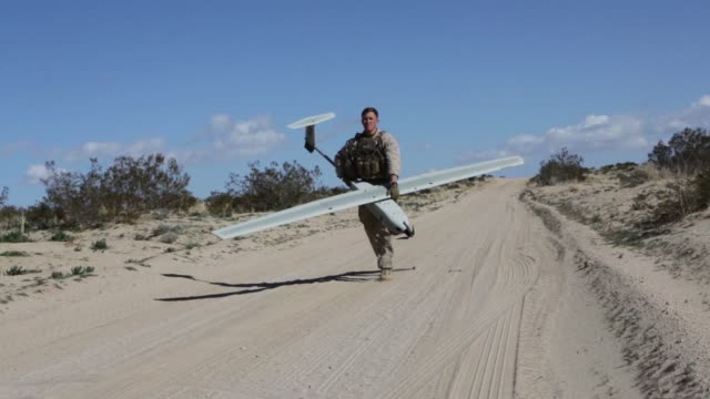 us marines with marine airground task force6 test an unmanned aeriel system lockheed martin stalker over range 220 during integrated training... - military exercise stock videos & royalty-free footage