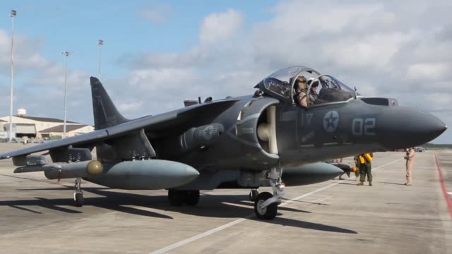 us marines with marine attack squadron 211 marine aircraft group 13 3rd marine aircraft wing prepare several av8b harrier jets for launch to... - military training stock videos & royalty-free footage