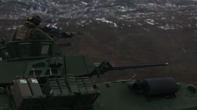 us marines with marine rotational forceeurope 191 conduct a combined armed live fire exercise during exercise northern screen at setermoen norway nov... - armoured personnel carrier stock videos & royalty-free footage